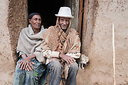 """Gazgibla, Ethiopia - 18.05.17  - Enanu Kibret Bogale, 67, who had trachoma in her right eye, at her home in Gazgibla, Amhara Region, Ethiopia, on May 18, 2017. She had a trichiasis surgery fail 2 years ago, but heard about CBM's surgeries and decided to try again. """"I was skeptical. Now everything is good. I had tears in my eyes for 5 years, but now I am free.""""  Also pictured is her husband, Asmarat Bogale."""