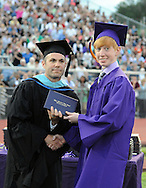 UPPER MORELAND, PA - JUNE 05: Assistant Principal Brian Staub (L) hands a diploma to Calvin Creighton  during Upper Moreland High School's 2014 graduation ceremony.June 5, 2014 in Upper Moreland, Pennsylvania. (Photo by William Thomas Cain/Cain Images)