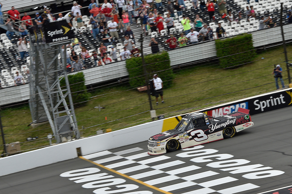 1-2 August, 2014, Long Pond, Pennsylvania USA<br /> Austin Dillon crosses the finish line for the win under the checkered flag<br /> &copy;2014, Scott R LePage <br /> LAT Photo USA