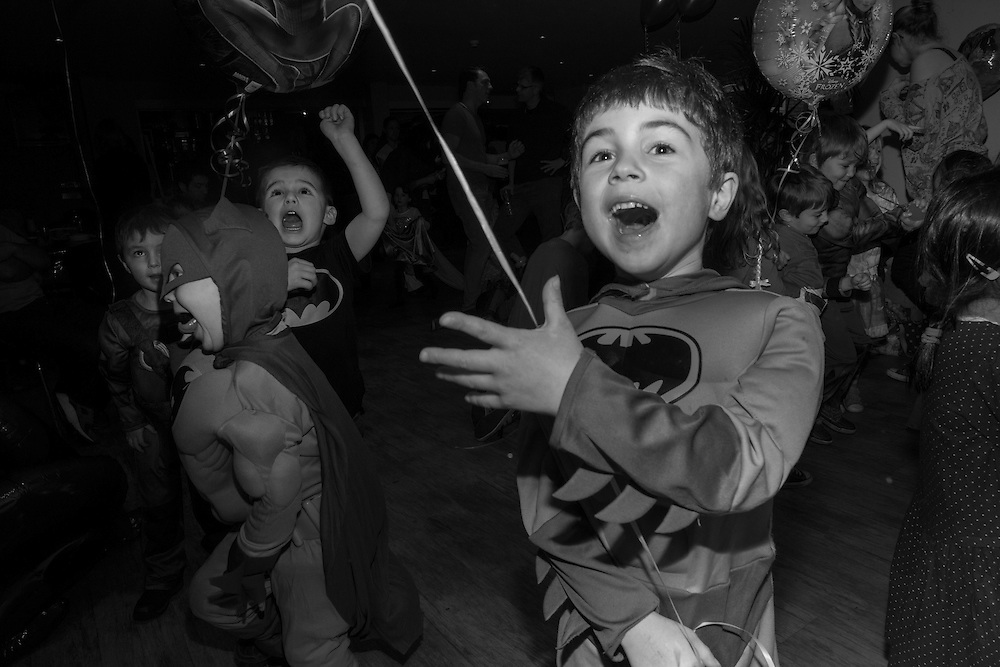 Children dressed as Batman dance during a fancy dress birthday party  in  Berkhamsted, England Saturday, Feb. 14, 2015 (Elizabeth Dalziel) #thesecretlifeofmothers #bringinguptheboys #dailylife