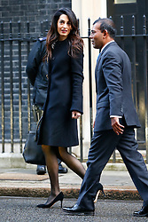 © Licensed to London News Pictures. 23/01/2016. London, UK. Amal Clooney and her client deposed former president of the Maldives Mohamed Nasheed leaving Downing Street after a meeting with David Cameron on Saturday, 23 January 2016. Photo credit: Tolga Akmen/LNP