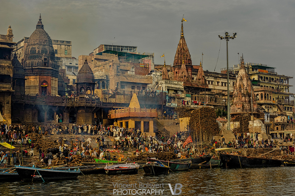 A view from the gange river of manikarnika burning ghat in varanasi, india