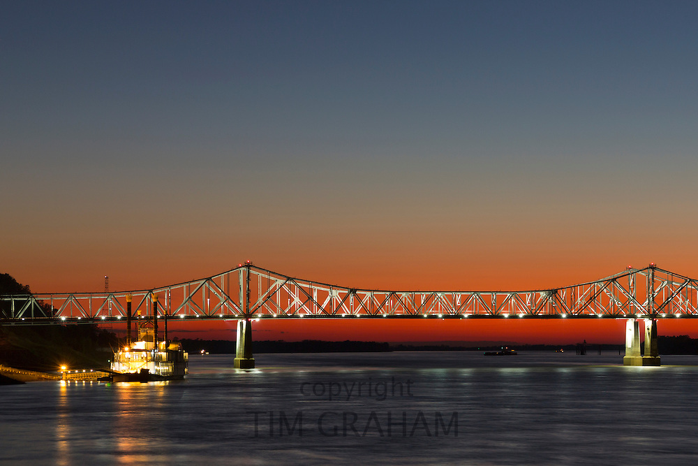 Nighttime scene of illuminated iron cantilever Natchez - Vidalia Bridge road bridge across the Mississippi River in Louisiana, USA