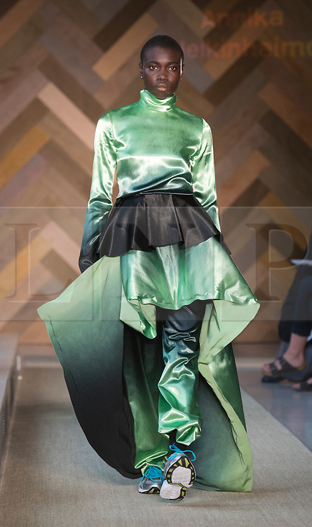 © Licensed to London News Pictures. 29/05/2014. London, England. Collection by Annika Heikinheimo. 30 students of the Royal College of Art's prestigious MA Fashion programme presented their final collections in  a runway show at the RCA building in Kensington. Photo credit: Bettina Strenske/LNP