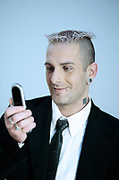 studio shot of isolated picture of a strange  businessman with piercing and tattoos