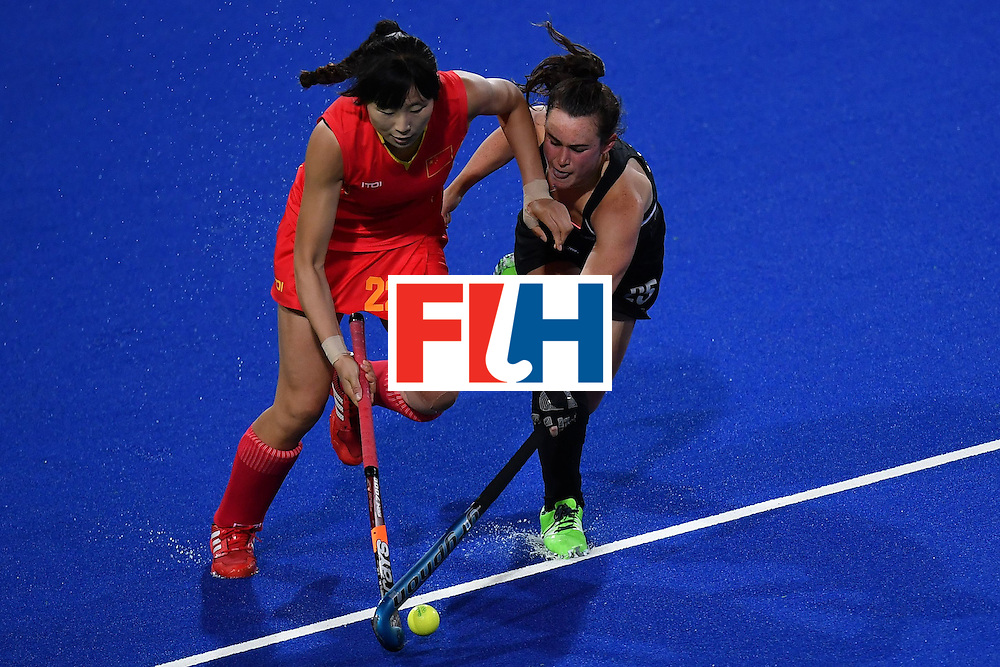 China's Song Qingling (l) AND New Zealand's Kelsey Smith vie during the women's field hockey China vs New Zealand match of the Rio 2016 Olympics Games at the Olympic Hockey Centre in Rio de Janeiro on August, 13 2016. / AFP / MANAN VATSYAYANA        (Photo credit should read MANAN VATSYAYANA/AFP/Getty Images)