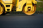 road roller used to compact the tarmac as part of road maintenance at Browns Bay, Auckland, New Zealand