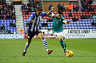 Emyr Huws of Wigan Athletic and Craig Conway of Blackburn Rovers battle for the ball. Skybet football league championship match , Wigan Athletic v Blackburn Rovers at the DW Stadium in Wigan, Lancs on Saturday 17th Jan 2015.<br /> pic by Chris Stading, Andrew Orchard sports photography.