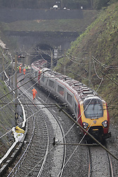 © Licensed to London News Pictures. 16/09/2016. Watford, UK. A train thought to be a rescue train enters the tunnel where a landslide can be seen at the entrance to a tunnel where a train has derailed near Watford, following heavy rainfall over night. Photo credit: Peter Macdiarmid/LNP