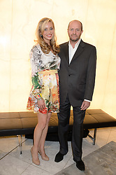 NOELLE RENO and SCOT YOUNG at the launch of the Odabash Macdonald Resort 2014 swimwear collection at ME Hotel, London on 25th June 2013.