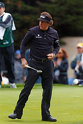 Feb 11, 2012; Pebble Beach CA, USA; Phil Mickelson after putting on the third hole during the third round of the AT&T Pebble Beach Pro-Am at Pebble Beach Golf Links. Mandatory Credit: Jason O. Watson-US PRESSWIRE