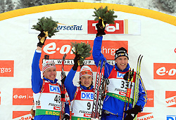 Ivan Tcherezov (2nd place), winner Maxim Tchoudov and Bjorn Ferry (3rd place) at flower ceremony at Men 20 km Individual at E.ON Ruhrgas IBU World Cup Biathlon in Hochfilzen (replacement Pokljuka), on December 18, 2008, in Hochfilzen, Austria. (Photo by Vid Ponikvar / Sportida)