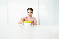 Girl (7-9) eating breakfast portrait