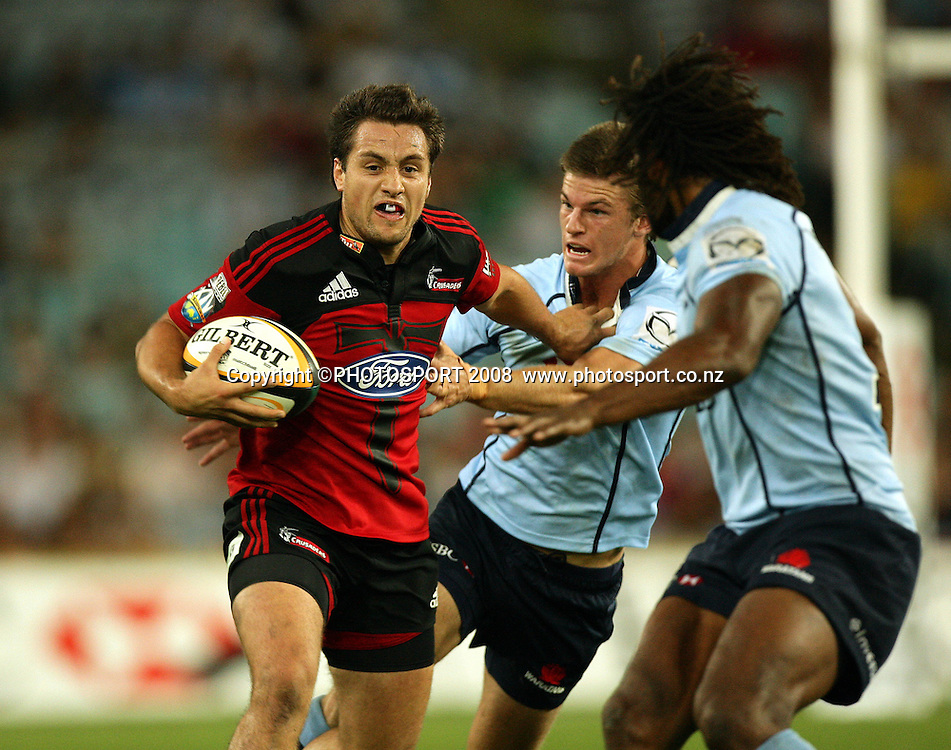 Tim Bateman fends Rob Horne.<br /> Super 14 rugby union match, Waratahs vs Crusaders, Sydney, Australia. <br /> Saturday 21 March 2009. Photo: Paul Seiser/PHOTOSPORT