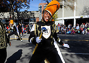 Tyree Debnam dances with other members of the Helping Hand Mission marching band during the 67th annual Raleigh Christmas Parade Saturday November 19, 2011, in Raleigh.