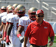 Lafayette High coach Anthony Hart leads the team onto the field vs. Evangel Christian in Shreveport, La.  on Saturday, September 10, 2011. Lafayette High won 35-34.