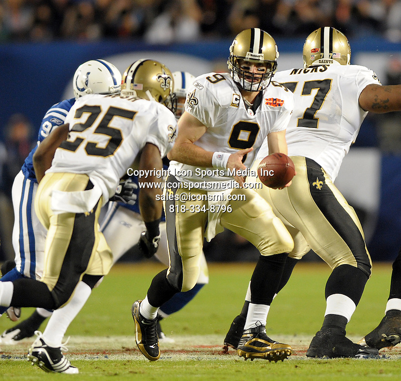 Feb. 07, 2010 - Miami Gardens, FL - Florida, USA - United States -  --   New Orleans Saints quarterback Drew Brees hands off the ball to running back Reggie Bush during the first quarter of Super Bowl XLIV at Sun Life Stadium.