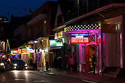 Street scene in famous Bourbon Street in French Quarter of New Orleans, USA