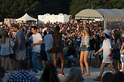 Music Midtown festival goers dance during a set by all - girl rock act HAIM.