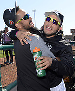 GLENDALE, ARIZONA - FEBRUARY 26:  Jose Abreu #79 and Yolmer Sanchez #5 of the Chicago White Sox have fun in the dugout prior to the game against the Oakland Athletics on February 26, 2018 at Camelback Ranch in Glendale Arizona.  (Photo by Ron Vesely)  Subject:   Jose Abreu; Yolmer Sanchez