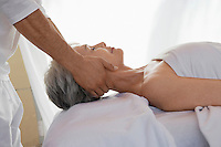 Woman Receiving a Massage head and shoulders