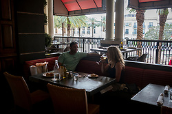 September 27, 2017 - West Palm Beach, Florida, U.S. - People enjoy happy hour at City Cellar in City Place on Wednesday, Sep. 27, 2017, in West Palm Beach, Florida. (Credit Image: © Calla Kessler/The Palm Beach Post via ZUMA Wire)