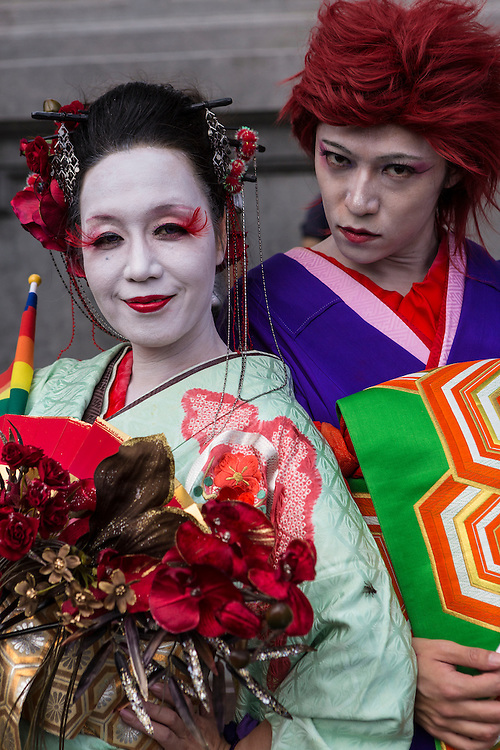 """Visitors from Japan in elaborate and traditional costumes pose before the start of LGBT Pride. The annual march through Taipei's city streets is the largest in Asia, with well over 50 000 people taking part. The 2014 event had the theme """"Walk in Queer's Shoes"""", to encourage the wider community to lend their support for equal marriage rights."""