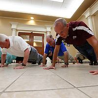 Thomas Wells | Buy at PHOTOS.DJOURNAL.COM<br /> Tupelo Mayor Jason Shelton, from left, Sen. Roger Wicker, Rep. Trent Kelly and Lee County Sheriff Jim Johnson come together to complete a 22 push up challenge to bring awareness to veteran sucides.