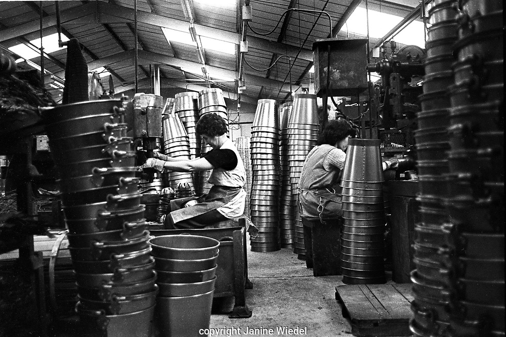 Female Chainmakers making buckets at Eliza Tinsley in The Black Country West Midlands UK