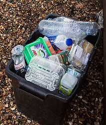 © Licensed to London News Pictures. 07/03/2018. Twickenham, UK. Family recycling remains in the driveway outside a property on South Road in Twickenham, south London where the body of a woman in her 40s was found with stab wounds on Monday evening. An hour earlier he bodies of two young boys, aged 7 and 10, and their father, were discovered at the foot of Birling Gap cliffs on the south coast, in what is suspected to be a murder suicide. Photo credit: Ben Cawthra/LNP