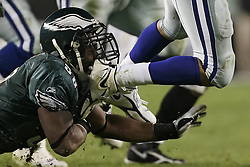Defensive end Trent Cole #58 of the Philadelphia Eagles sacks quarterback Drew Bledsoe #11 of the Dallas Cowboys at Lincoln Financial Field on Monday, November 14, 2005 in Philadelphia, Pennsylvania. The Dallas Cowboys defeated the Philadelphia Eagles 21-20.
