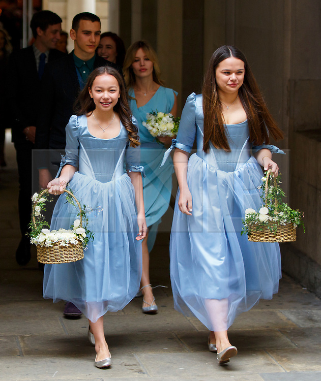 © Licensed to London News Pictures. 05/03/2016. London, UK. Bridesmaids Chloe Murdoch and Grace Murdoch leaving Rupert Murdoch and Jerry Hall's wedding ceremony at St Bride's Church in Fleet Street, London on Saturday, 5 March 2016. Photo credit: Tolga Akmen/LNP