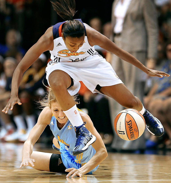 Connecticut Sun's Renee Montgomery, top and Chicago Sky's Allie Quigley, bottom chase a loose ball during the first half of a WNBA basketball game in Uncasville, Conn.(AP Photo/Jessica Hill)