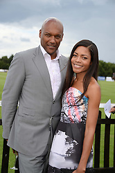 COLIN SALMON and NAOMIE HARRIS at the Audi International Polo at Guards Polo Windsor Great Park, Egham, Surrey on 28th July 2013.