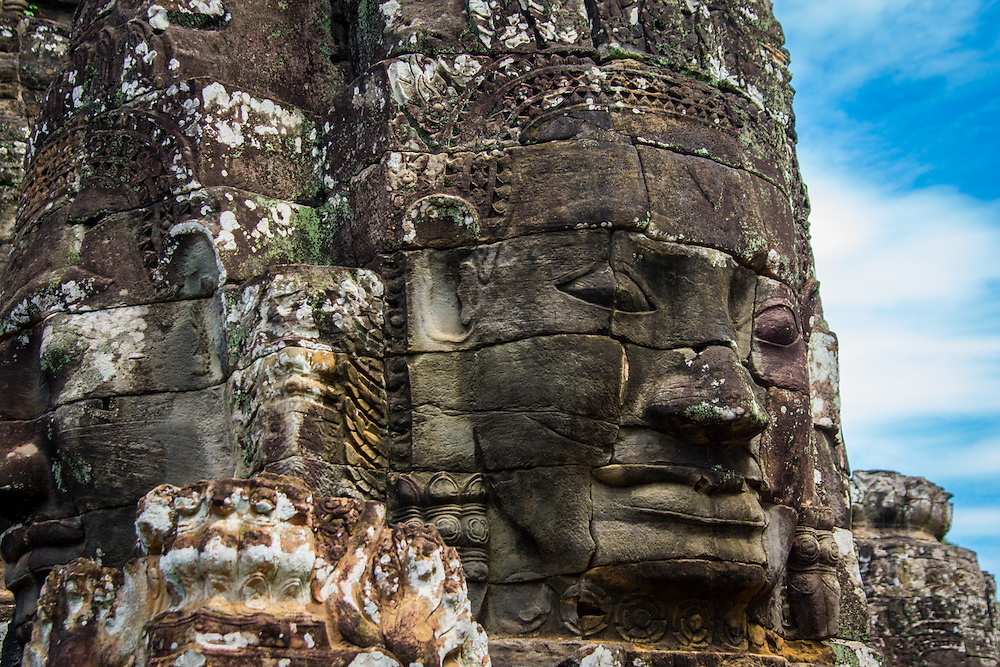 Bayon is a richly decorated Khmer temple at Angkor in Cambodia.  It was built by the Mahayana Buddhist King Jayavarman as the official state temple in the late 12th century or early 13th century.