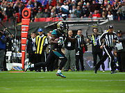Jacksonville Jaguars T.J. Yeldon running free to score a touchdown during the Buffalo Bills v Jacksonville Jaguars NFL International Series match at Wembley Stadium, London, England on 25 October 2015. Photo by Matthew Redman.
