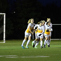 3rd year midfielder Nikita Senko (9) of the Regina Cougars celebrates Karlee Vorrieter's (11) equalizing goal late in the 2nd half during the Women's Soccer home game on October 7 at U of R Field. Credit: Arthur Ward/Arthur Images
