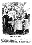 """Utile Cum Dulce. Inquisitive gent. """"You will - a - think me very indiscreet - but I cannot help wondering what this elaborately-carved and curiously ramified structure is for. Is it for ornament only, or intended to heat the house, or something?"""" Fastidious host. """"O, it's the drains! I like to have 'em where I can look after 'em myself. Pooty design, ain' it? Majolic, you know... Have some chicken?"""""""