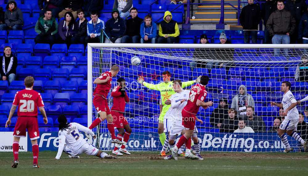 BIRKENHEAD, ENGLAND - Saturday, February 18, 2012: Charlton Athletic's Michael Morrison scores the equalising 1-1 goal against Tranmere Rovers' goalkeeper Owain Fon Williams during the Football League One match at Prenton Park. (Pic by Vegard Grott/Propaganda)