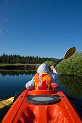 """Boy Kayaking on Prosser Reservoir 2"" -This photograph of a boy kayaking was photographed on Prosser Reservoir in Truckee, CA."