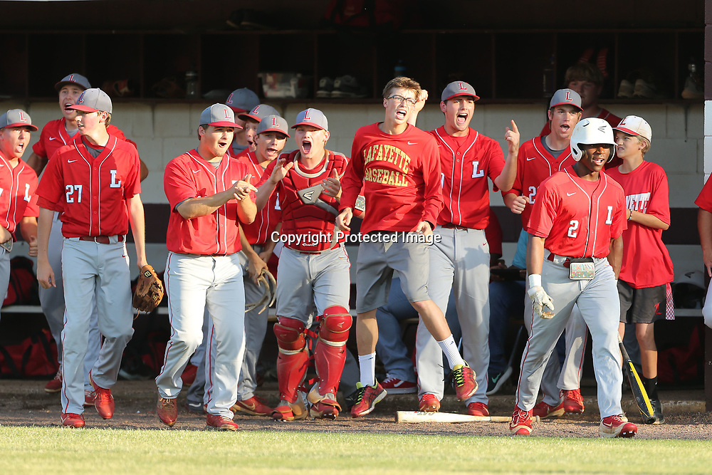 The Lafayette baseball team celebrates after Corey Taylor scores to put the Commodores up 2-0 in the top of the first inning against Houston.