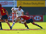 Canadian Brittany Benn fends off a tackler during the Emirates Dubai rugby sevens match between Canada and Spain  at the Sevens Stadium, Al Ain Road, United Arab Emirates on 1 December 2016. Photo by Ian  Muir.*** during the Emirates Dubai rugby sevens match between *** and ***  at the Sevens Stadium, Al Ain Road, United Arab Emirates on 1 December 2016. Photo by Ian  Muir.