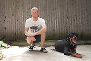 Tom and Wally the dog in their driveway, Dorchester, MA