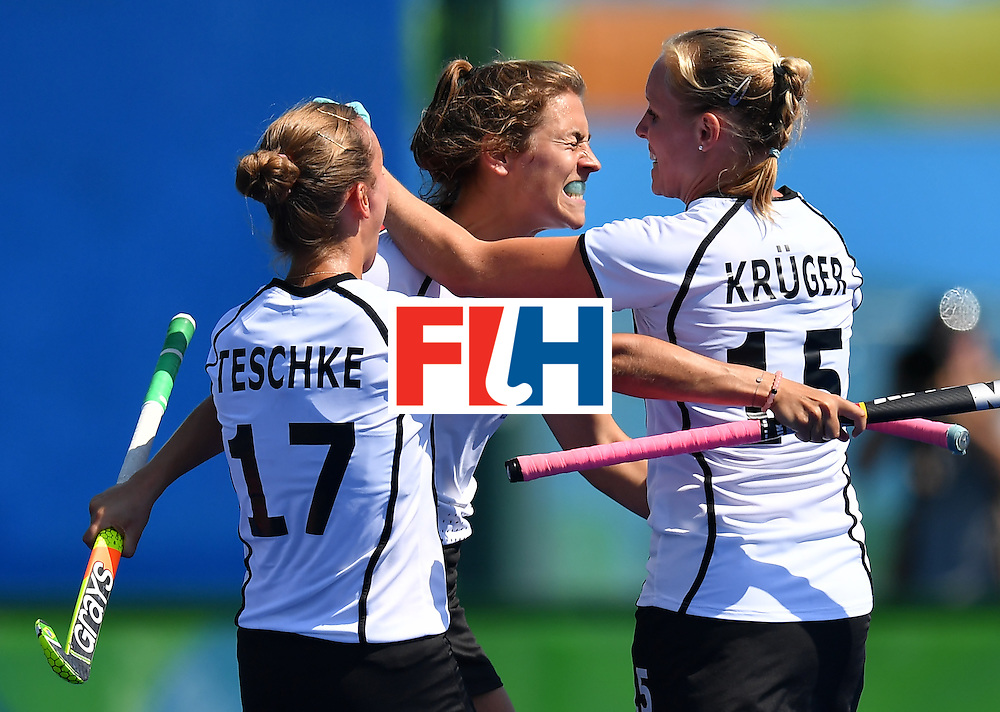 Germany's Marie Mavers (C) celebrates a goal with teammates during the women's quarterfinal field hockey USA vs Germany match of the Rio 2016 Olympics Games at the Olympic Hockey Centre in Rio de Janeiro on August 15, 2016. / AFP / MANAN VATSYAYANA        (Photo credit should read MANAN VATSYAYANA/AFP/Getty Images)