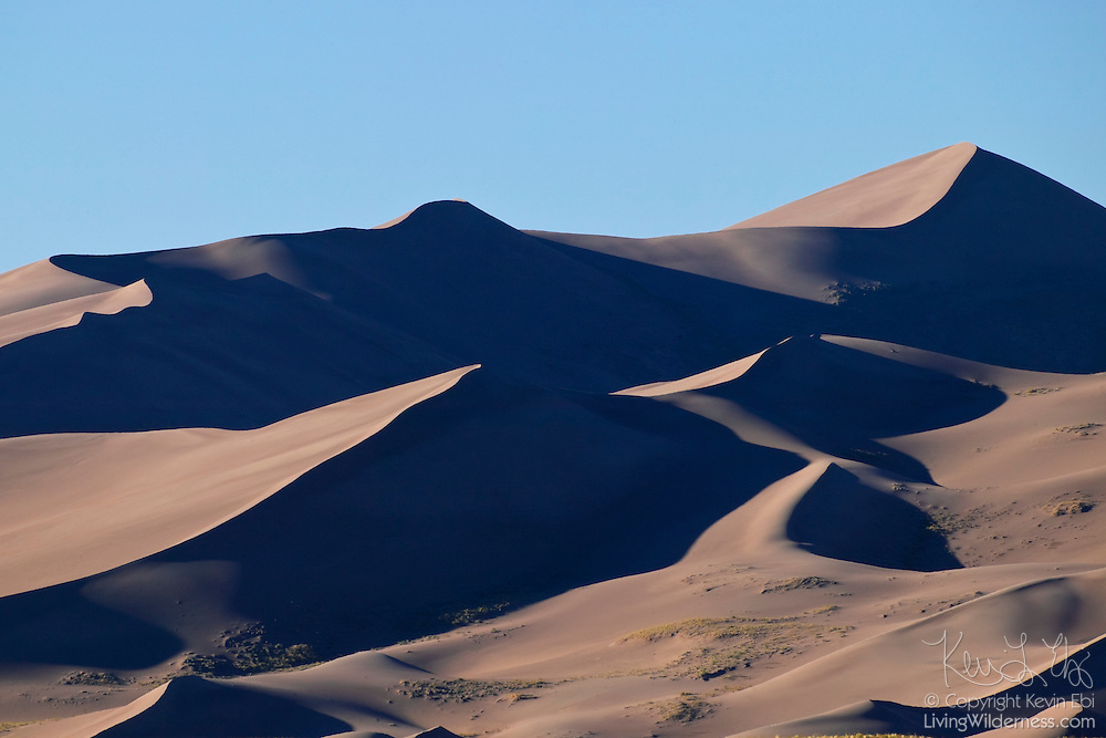 Great Sand Dunes National Park is home to the tallest sand dunes in North America. The tallest of the dunes climb 750 feet from the San Luis Valley. The valley is very windy and the sands are trapped by the Sangre de Christo Mountains, not visible in this frame.
