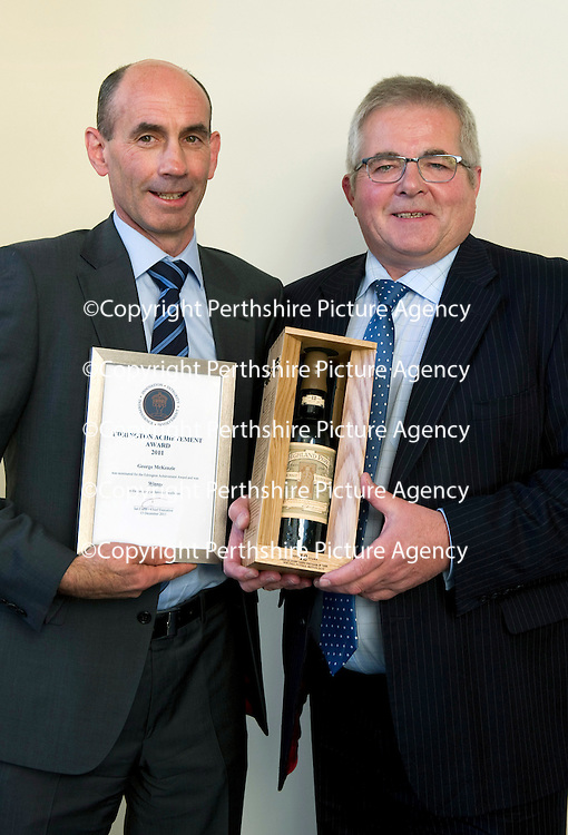 Edrington Achievement Awards....15.12.11<br /> Chief Exec Ian Curle presents an award to George McKenzie<br /> Picture by Graeme Hart.<br /> Copyright Perthshire Picture Agency<br /> Tel: 01738 623350  Mobile: 07990 594431