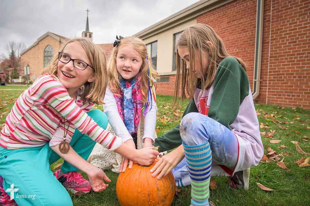 4th grade students mark their pumpkin for carving during an outside classroom activity on Thursday, Oct. 27, 2016, at First Immanuel Lutheran School in Cedarburg, Wis. LCMS Communications/Erik M. Lunsford