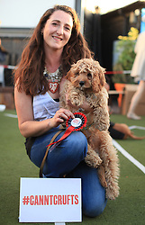 © Licensed to London News Pictures. 17/06/2014. London, UK. Liza Morgan and her Cavapoo, Harvey, win the Best In Show of the Cannt Crufts annual dog show at the Queen of Hoxton's rooftop, east London. Photo credit : LNP