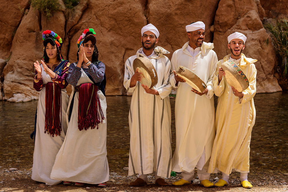 North Africa, Africa, African, Morocco, Moroccan, adorned Berber woman singing during the Rose festival at the Gorges de Dades