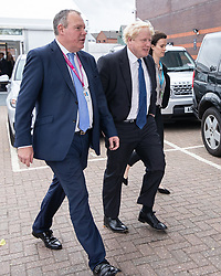 © Licensed to London News Pictures . 02/10/2018. Birmingham, UK. BORIS JOHNSON arrives with CONOR BURNS MP (l) and passes through security at the conference on day 3 of the Conservative Party conference at the ICC in Birmingham . Photo credit: Joel Goodman/LNP